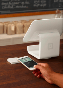 A Square contactless payments system, using an iPhone and American Express on an Apple Wallet app.
