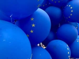 A bunch of blue balloons from the European Union. Visa and Mastercard have lowered their interchange fees in the EU