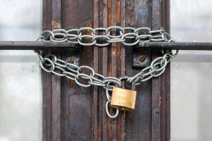 """A padlock and door. Because it's hard to symbolize """"fraud prevention"""" without using a photo of a laptop."""