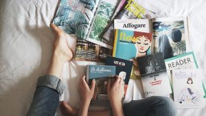 Several magazines on a bed. Visa has updated their policies for subscription merchants.