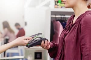 Contactless payment with mobile phone. Mom-and-pop shops often bear the brunt of chargebacks.