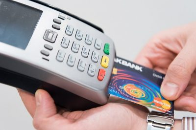 A credit card reader. Your payment services provider can provide you with a machine like this.